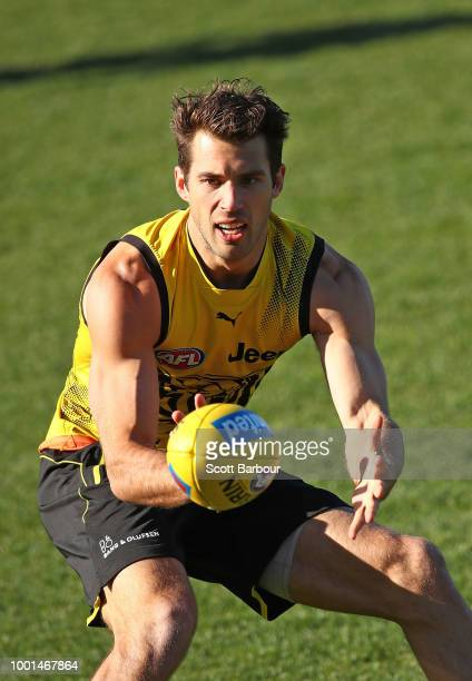 Alex Rance of the Tigers runs with the ball during a Richmond Tigers AFL training session at Punt Road Oval on July 19 2018 in Melbourne Australia