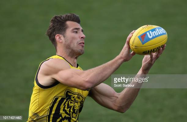 Alex Rance of the Tigers runs with the ball during a Richmond Tigers AFL training session at Punt Road Oval on August 16 2018 in Melbourne Australia