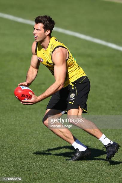 Alex Rance of the Tigers runs with the ball during a Richmond Tigers AFL training session at Punt Road Oval on September 4 2018 in Melbourne Australia