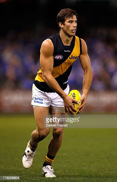 Alex Rance of the Tigers runs with the ball during the round 15 AFL match between the North Melbourne Kangaroos and the Richmond Tigers at Etihad...