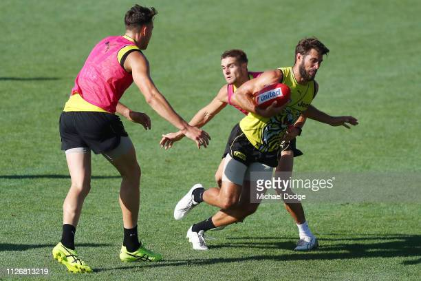 Alex Rance of the Tigers runs with the ball from Jayden Short of the Tigers during a Richmond Tigers AFL training session at Punt Road Oval on...