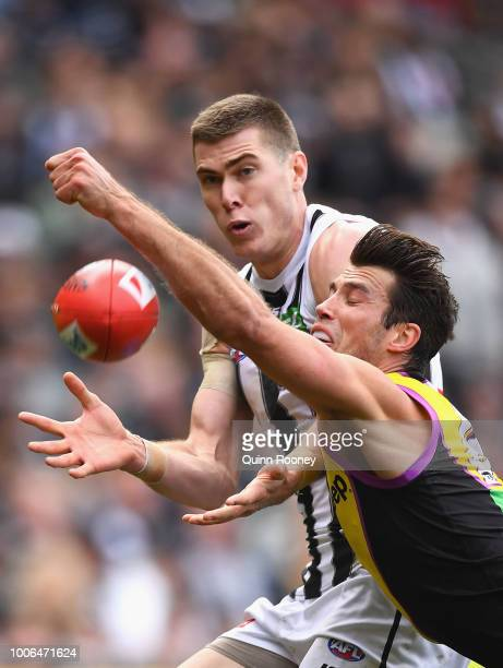 Alex Rance of the Tigers spoils a mark by Mason Cox of the Magpies during the round 19 AFL match between the Richmond Tigers and the Collingwood...