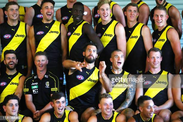 Alex Rance of the Tigers throws paper balls at media as Dustin Martin of the Tigers reacts during the AFL Richmond Tigers team photo session at Punt...