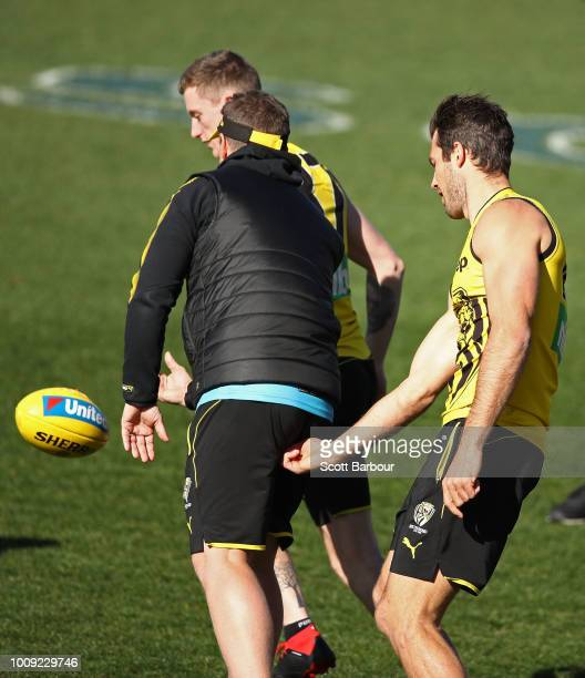 Alex Rance of the Tigers touches Damien Hardwick coach of the Tigers during a Richmond Tigers AFL training session at Punt Road Oval on August 2 2018...