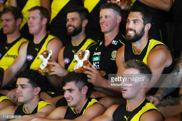 Alex Rance of the Tigersholds up a toy Tiger during the AFL Richmond Tigers team photo session at Punt Road Oval on February 22 2019 in Melbourne...