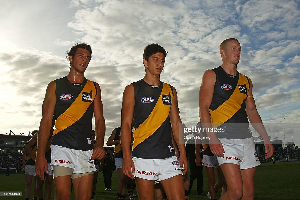 Alex Rance, Robin Nahas and Kelvin Moore of the Tigers leave the ground after losing the round six AFL match between the Geelong Cats and the Richmond Tigers at Skilled Stadium on May 2, 2010 in Melbourne, Australia.