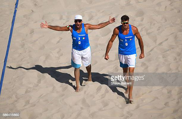 Alex Ranghieri and Adrian Carambula Raurich of Italy celebrate during the Men's Beach Volleyball preliminary round Pool A match against Clemens...