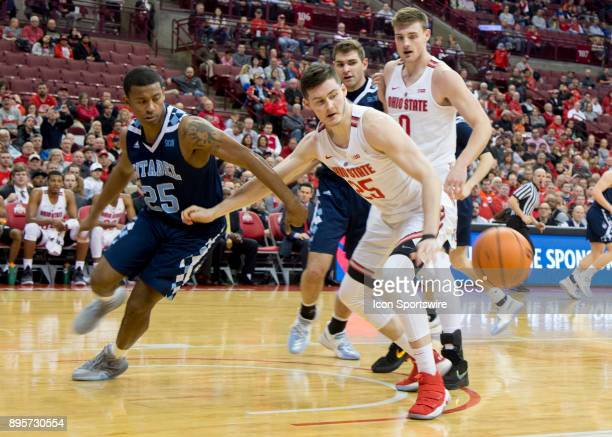 Alex Reed of the Citadel Bulldogs and Kyle Young of the Ohio State Buckeyes chase the loose ball during the game between the Ohio State Buckeyes and...