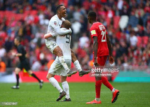 Alex Reid celebrates with hsi team mate Danny Rowe of AFC Flyde at the end of the FA Trophy Final match between Leyton Orient and AFC Fylde at...
