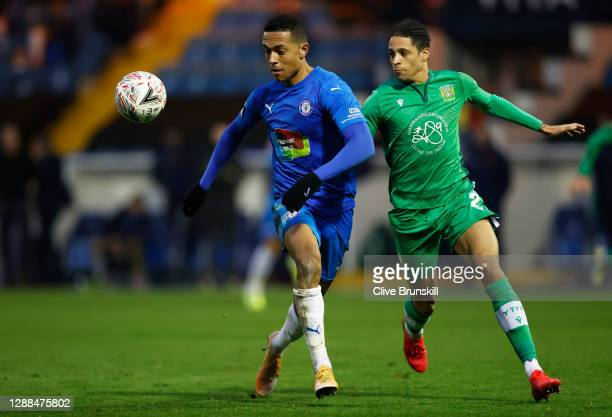 Alex Reid of Stockport County in action with Daniel Leadbitter of Yeovil Town during the Emirates FA Cup Second Round match between Stockport County...