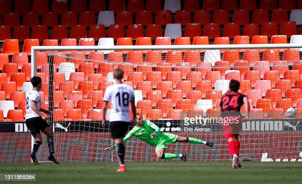 Alex Remiro of Real Sociedad looks on as Carlos Soler of Valencia CF takes a penalty and misses during the La Liga Santander match between Valencia...