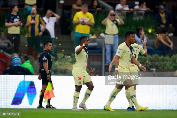 Alex Renato Ibarra of America celebrates with teammates after scoring the first goal of his team during the semifinal second leg match between...