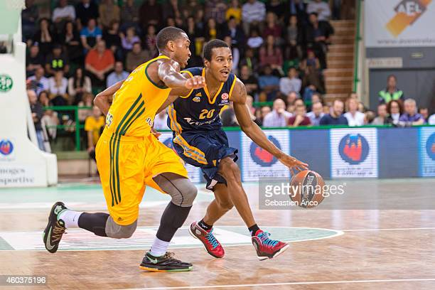 Alex Renfroe #20 of Alba Berlin competes with Jamar Smith #5 of Limoges CSP during the 20142015 Turkish Airlines Euroleague Basketball Regular Season...