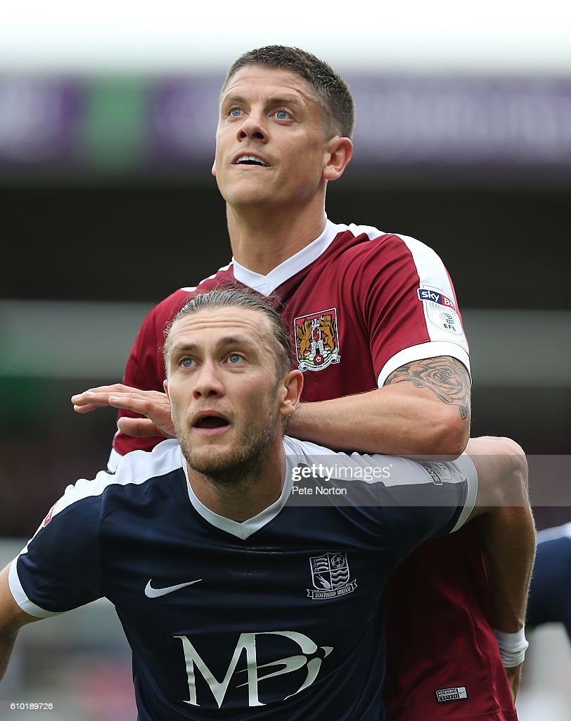 Alex Revell of Northampotn Town and Ben Coker of Southend United in action during the Sky Bet League One match between Northampton Town and Southend United at Sixfields on September 24, 2016 in Northampton, England.