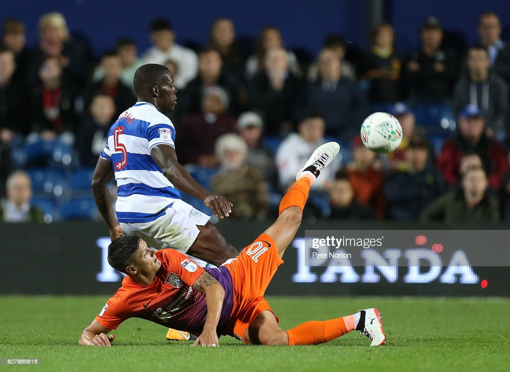 Alex Revell of Northampton Town contests the ball with Nedum Onuoha of Queens Park Rangers during the Carabao Cup first round match between Queens Park Rangers and Northampton Town at Loftus Road on August 8, 2017 in London, England.