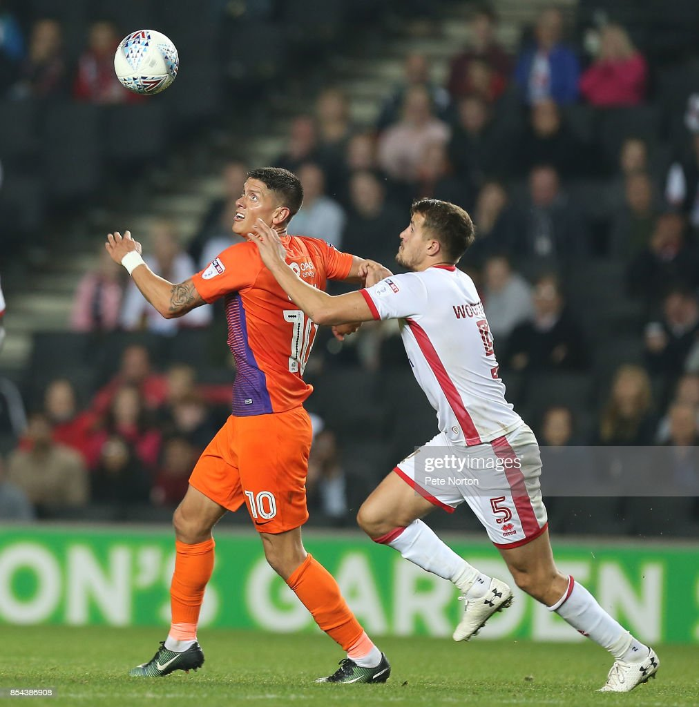 Alex Revell of Northampton Town contests the ball with Scott Wootton of Milton Keynes Dons during the Sky Bet League One match between Milton Keynes Dons and Northampton Town at StadiumMK on September 26, 2017 in Milton Keynes, England.