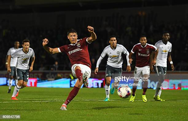 Alex Revell of Northampton Town scores his sides first goal during the EFL Cup Third Round match between Northampton Town and Manchester United at...