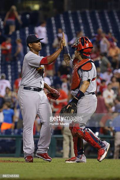 Alex Reyes of the St Louis Cardinals high fives Yadier Molina after saving a game in the 11th inning against the Philadelphia Phillies at Citizens...