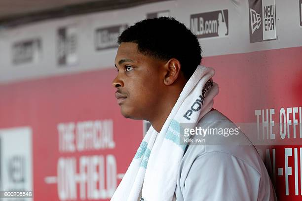 Alex Reyes of the St Louis Cardinals sits in the dugout between innings of the game against the Cincinnati Reds at Great American Ball Park on...