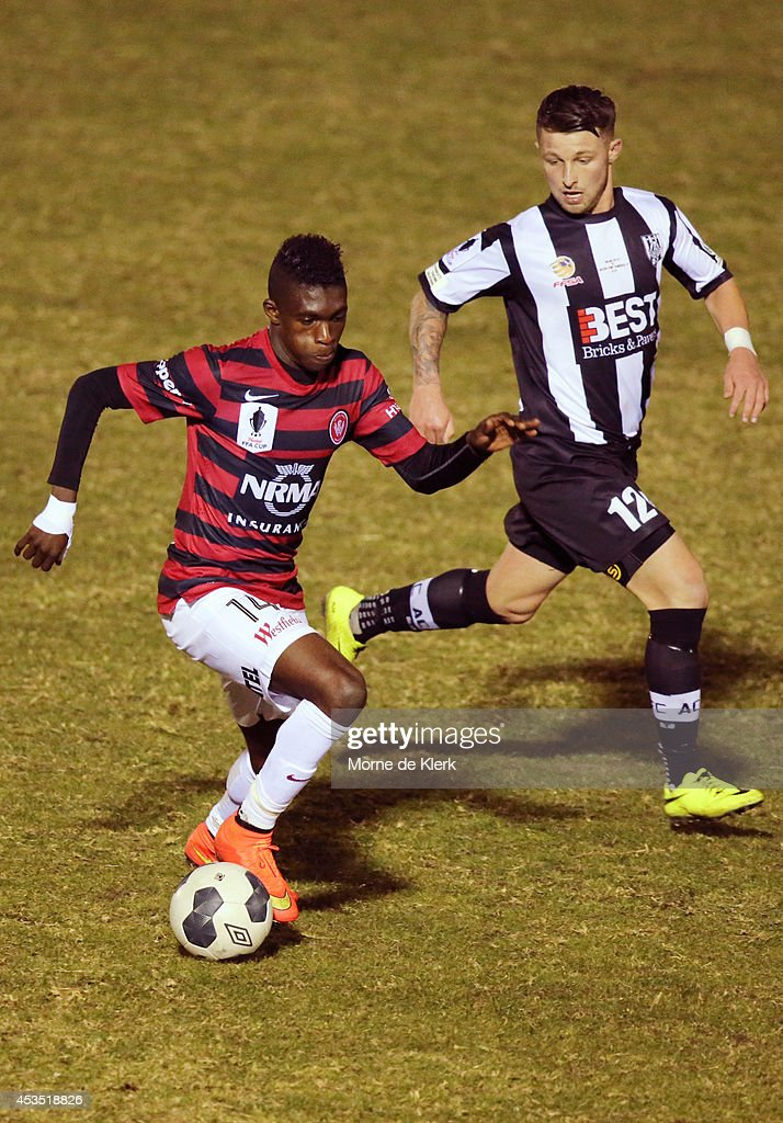 Alex Rideout of Adelaide City competes with Kwabena Appiah of Western Sydney during the FFA Cup match between Adelaide City and Western Sydney Wanderers at Marden Sports Complex on August 12, 2014 in Adelaide, Australia.