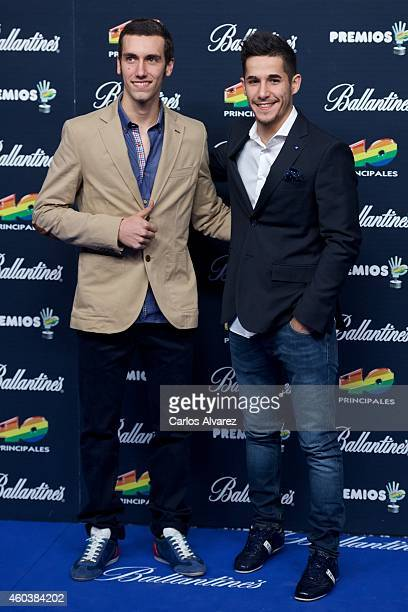Alex Rins and Lluis Salom attend the '40 Principales' awards 2013 photocall at the Barclaycard Center on December 12 2014 in Madrid Spain