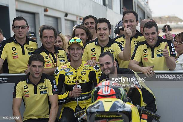 Alex Rins of Spain and Pagina Amarillas HP40 celebrates with team at the end of the qualifying practice during the MotoGP of Spain Qualifying at...