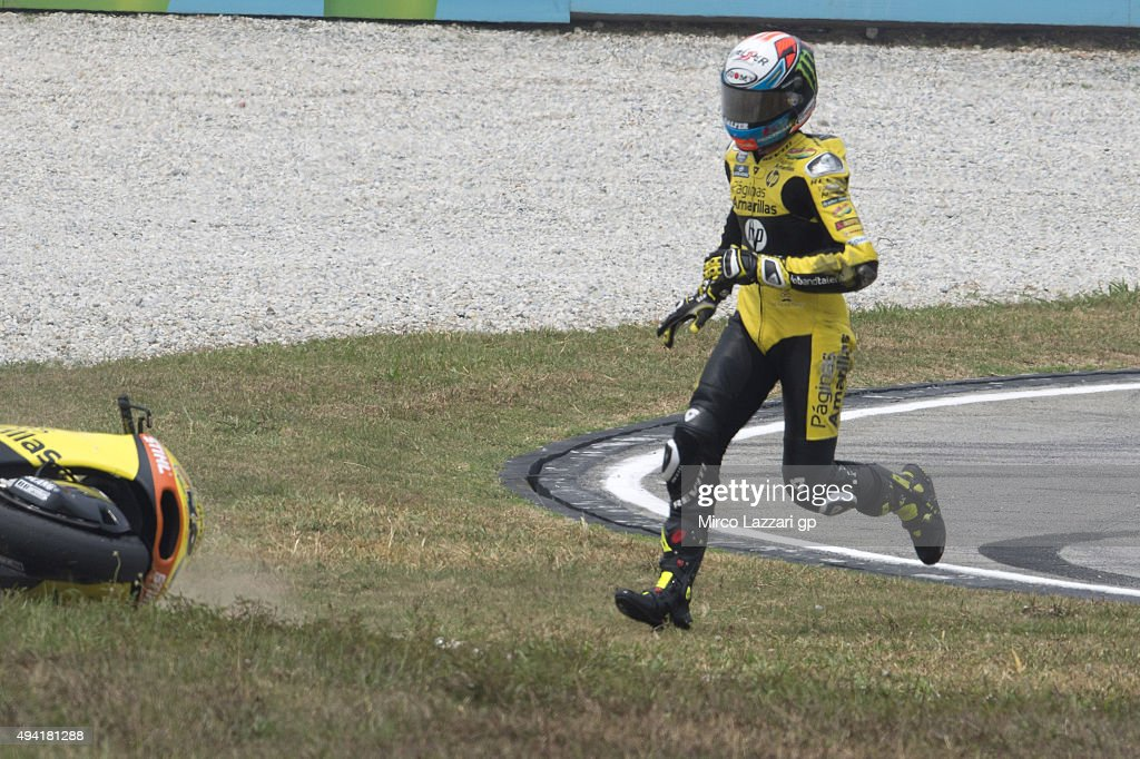 Alex Rins of Spain and Pagina Amarillas HP40 crashed out during the Moto2 race during the MotoGP Of Malaysia at Sepang Circuit on October 25, 2015 in Kuala Lumpur, Malaysia.