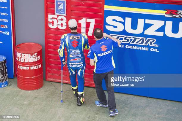 Alex Rins of Spain and Team Suzuki ECSTAR arrives in box with crutch during the MotoGp of Argentina Free Practice on April 7 2017 in Rio Hondo...