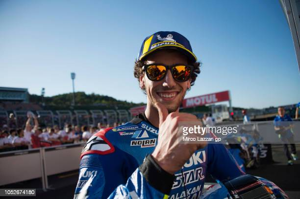 Alex Rins of Spain and Team Suzuki ECSTAR celebrates the third place under the podium at the end of the MotoGP race during the MotoGP of Japan Race...