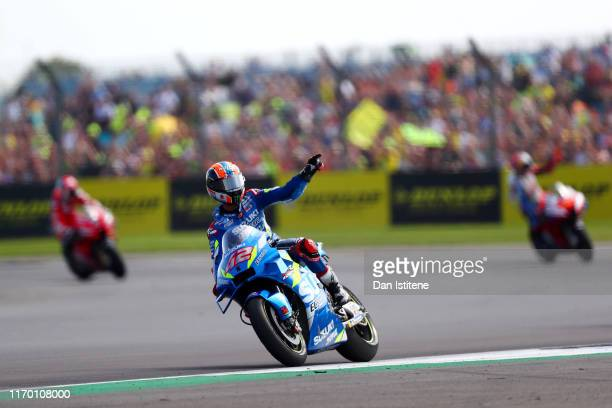 Alex Rins of Spain and Team Suzuki Ecstar celebrates victory after the MotoGP of Great Britain at Silverstone Circuit on August 25 2019 in...