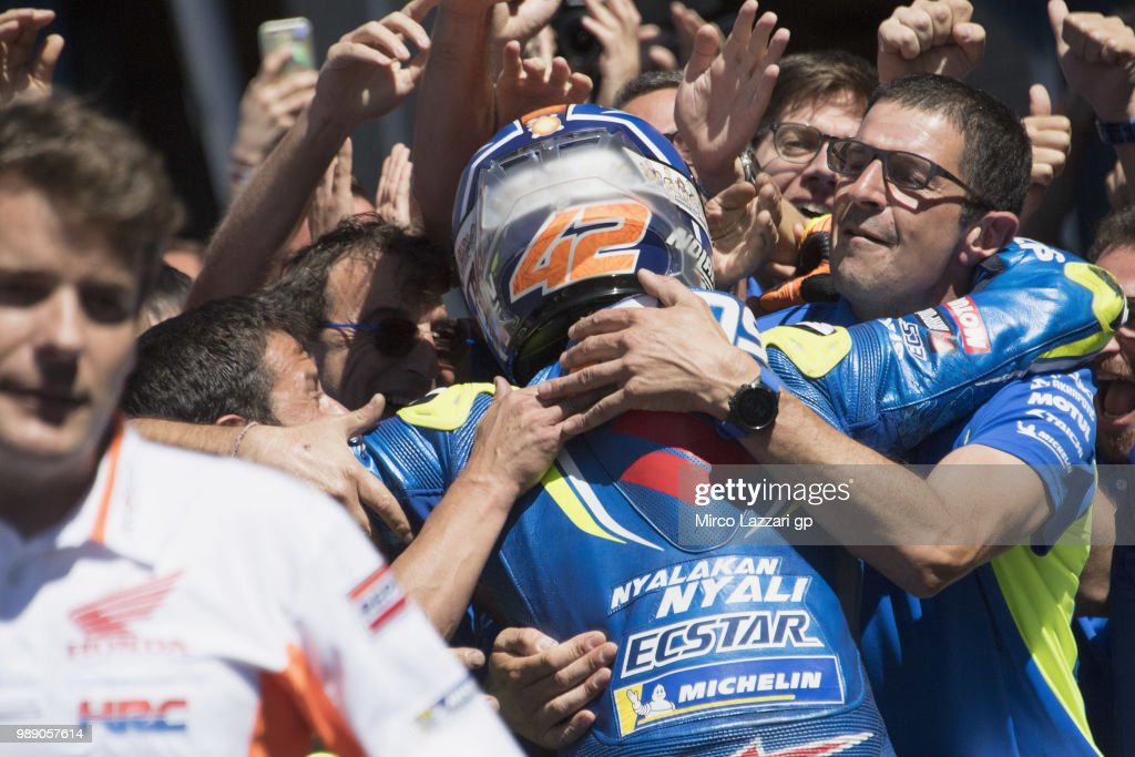 Alex Rins of Spain and Team Suzuki ECSTAR celebrates with the team under the podium during the MotoGp race during the MotoGP Netherlands - Race on July 1, 2018 in Assen, Netherlands.