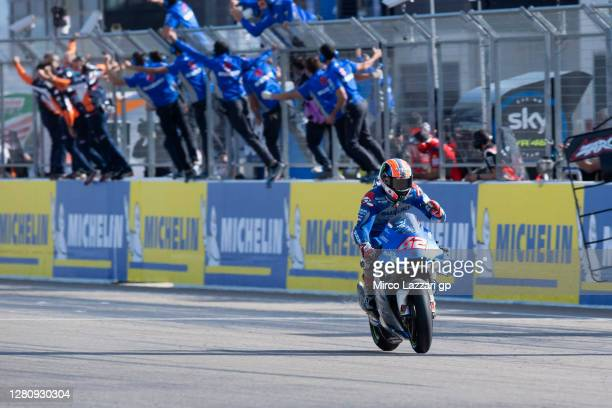 Alex Rins of Spain and Team Suzuki ECSTAR cuts the finish lane and celebrates the victory during the MotoGP race during the MotoGP of Aragon at...