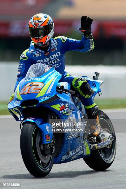 Alex Rins of Spain and Team Suzuki Ecstar greets the fans after free practice for the MotoGP of Catalunya at Circuit de Catalunya on June 15 2018 in...
