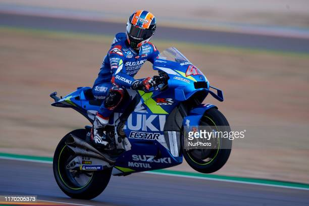 Alex Rins of Spain and Team Suzuki Ecstar making a wheelie during of the Gran Premio Michellin de Aragon of world championship of MotoGP at Motorland...