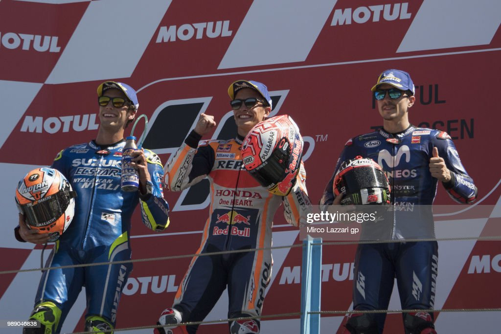 Alex Rins of Spain and Team Suzuki ECSTAR, Marc Marquez of Spain and Repsol Honda Team and Maverick Vinales of Spain and Movistar Yamaha MotoGP celebrate on the podium at the end of the MotoGp race during the MotoGP Netherlands - Race on July 1, 2018 in Assen, Netherlands.