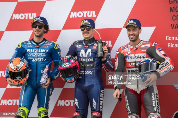Alex Rins of Spain and Team Suzuki ECSTAR Maverick Vinales of Spain and Movistar Yamaha MotoGP and Andrea Dovizioso of Italy and Ducati Team pose at...