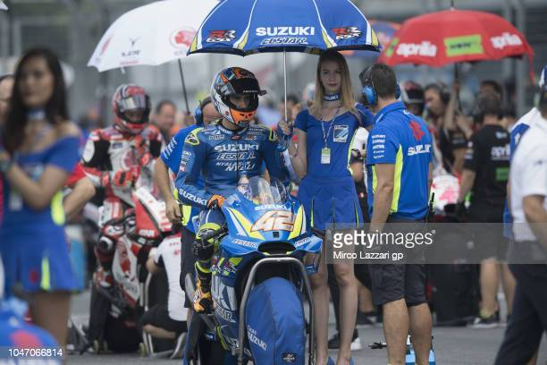 Alex Rins of Spain and Team Suzuki ECSTAR prepares to start on the grid during the MotoGP race during the MotoGP Of Thailand Race on October 7 2018...