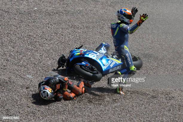 Alex Rins of Spain and Team Suzuki Ecstar reacts after crashing with Pol Espargaro of Spain and Red Bull KTM Team during the MotoGP of Germany at...