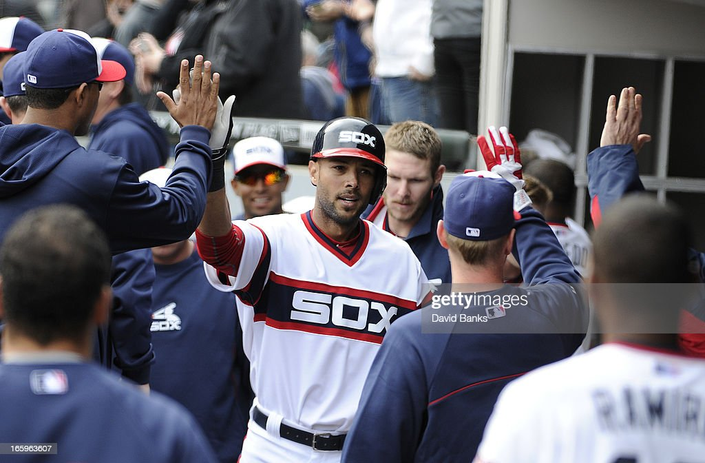 Alex Rios #51 of the Chicago White Sox is greeted by his teammatesthe bases after hitting a home-run against the Seattle Mariners in the seventh inning on April 7, 2013 at U.S. Cellular Field in Chicago, Illinois.