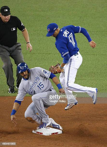 Alex Rios of the Kansas City Royals is tagged out by Ryan Goins of the Toronto Blue Jays as he attempts to steal second base in the fourth inning...