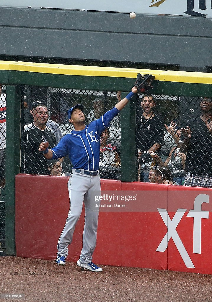 Alex Rios #15 of the Kansas City Royals leaps to try and catch a home run ball hit by Alexei Ramirez of the Chicago White Sox in the 7th inning rain at U.S. Cellular Field on July 18, 2015 in Chicago, Illinois. The Royals defeated the White Sox 7-6 in 13 innings.