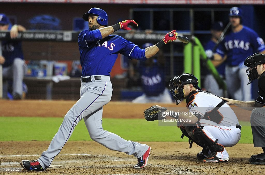 Alex Rios #51 of the Texas Rangers bats during a MLB game against the Miami Marlins at Marlins Park on August 19, 2014 in Miami, Florida.
