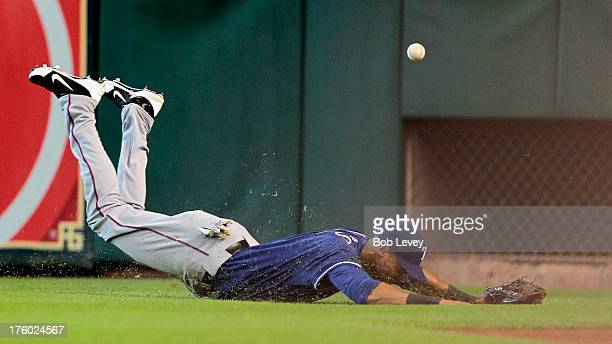 Alex Rios of the Texas Rangers dives but comes up short on a line drive hit by Jose Altuve of the Houston Astros in the first inning at Minute Maid...