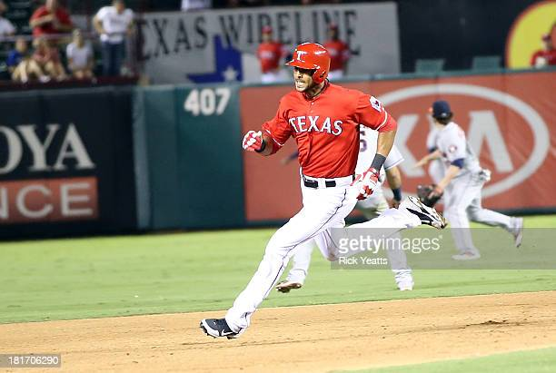 Alex Rios of the Texas Rangers rounds second base after hitting an RBI triple in the sixth inning to complete a cycle during a game against the...