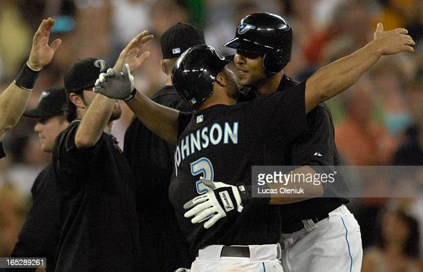 Alex Rios shares a hug with Reed Johnson after the allstar drove in Johnson in the bottom of the ninth to beat the Cleveland Indians 10 at the Rogers...