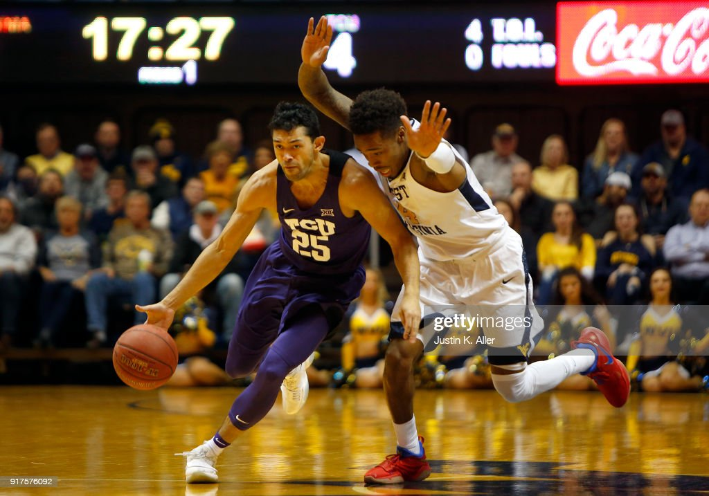 Alex Robinson #25 of the TCU Horned Frogs brings the ball up court against Daxter Miles Jr. #4 of the West Virginia Mountaineers at the WVU Coliseum on February 12, 2018 in Morgantown, West Virginia.