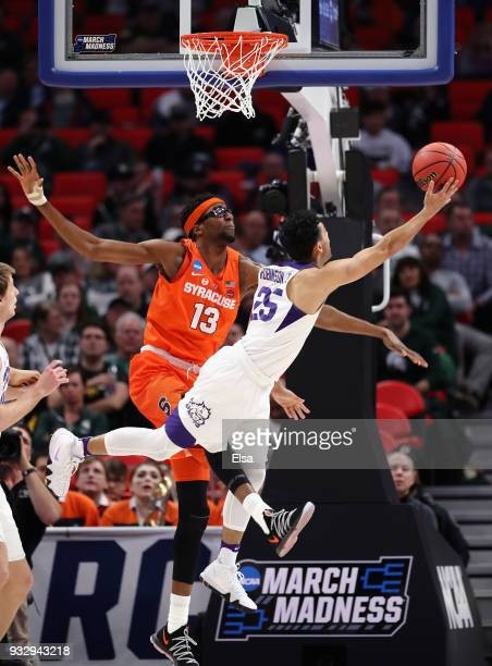 Alex Robinson of the TCU Horned Frogs drives to the basket against Paschal Chukwu of the Syracuse Orange during the first half in the first round of...