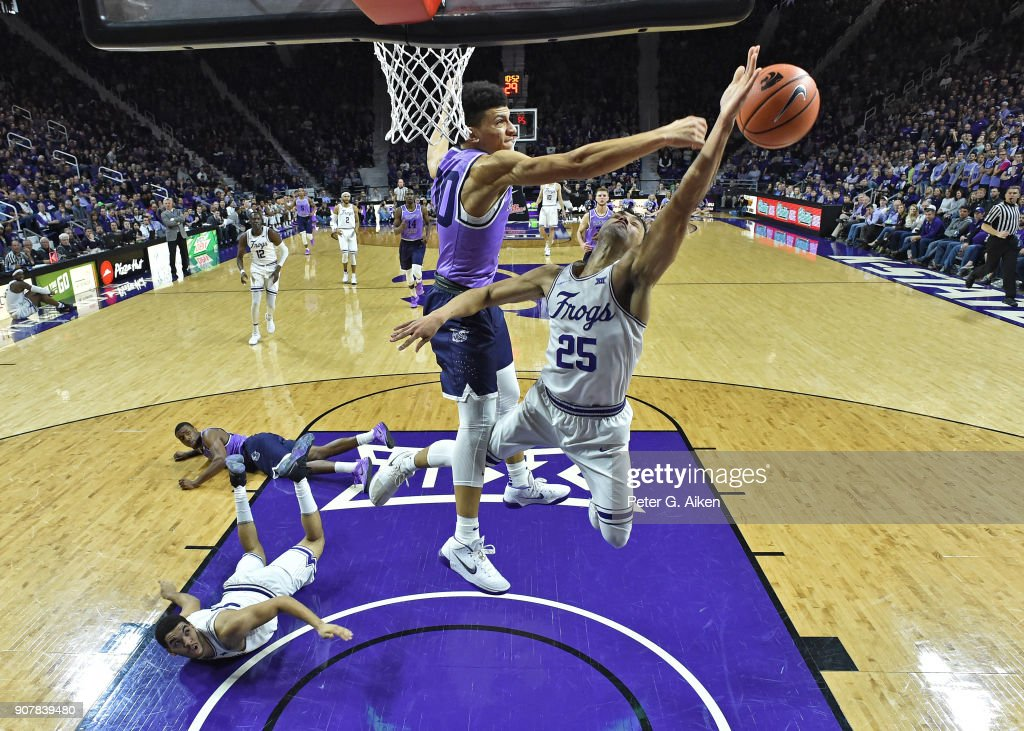 Alex Robinson #25 of the TCU Horned Frogs has his shot blocked by Mike McGuirl #00 of the Kansas State Wildcats during the second half on January 20, 2018 at Bramlage Coliseum in Manhattan, Kansas.