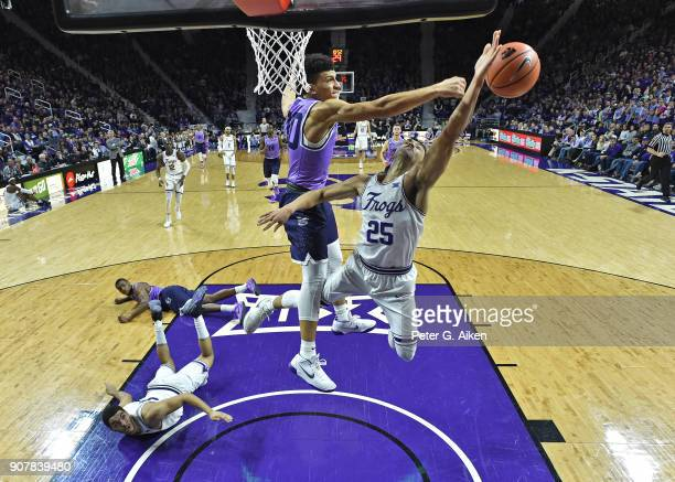 Alex Robinson of the TCU Horned Frogs has his shot blocked by Mike McGuirl of the Kansas State Wildcats during the second half on January 20 2018 at...
