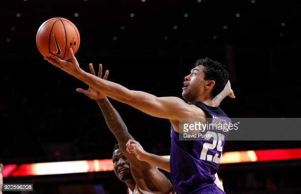 Alex Robinson of the TCU Horned Frogs lays up a shot as Cameron Lard of the Iowa State Cyclones defends in the second half of play at Hilton Coliseum...